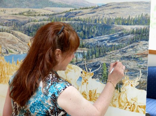 Linda hard at work on her Conservation Artist of the Year caribou painting.